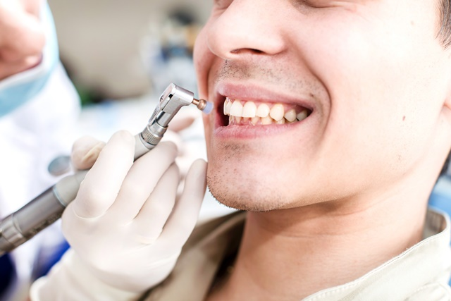 Patient getting his teeth polished