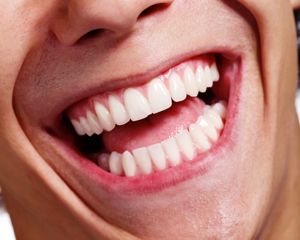 Close up of man's healthy, white smile and teeth